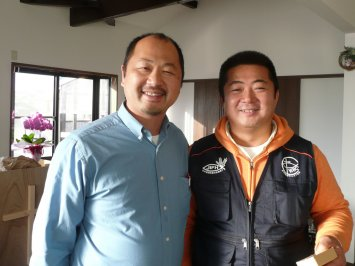 Takeshi Takazawa standing with Pastor Koji Kumada, the Mennonite Brethren pastor of the church, originally planted by the Conservative Baptists.